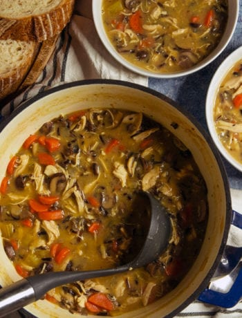Creamy Chicken and Wild Rice Soup in Bowls served with Bread