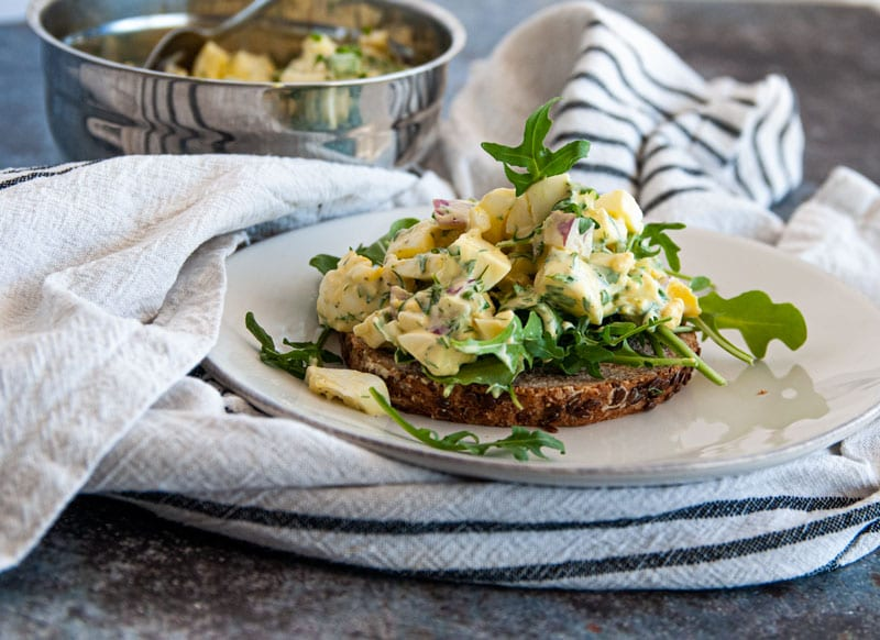 Egg Salad on Whole Wheat Toast with Arugula, Mixing bowl in the background