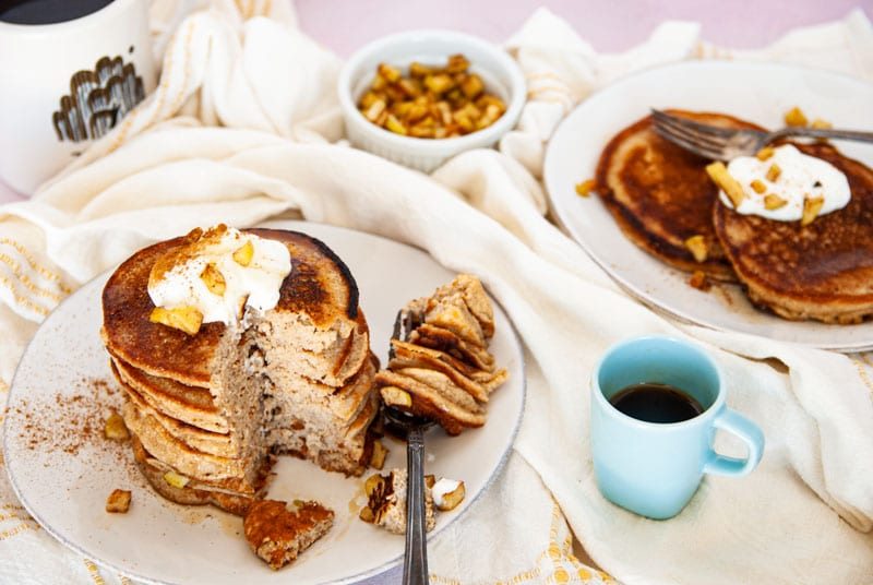 Pancakes on white plates with a bite missing