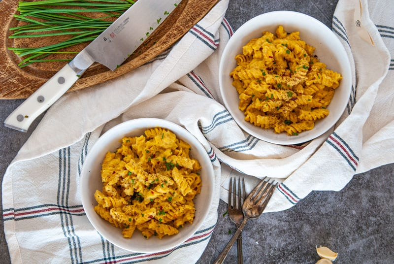 Two Bowls of Pumpkin Mac and cheese in white bowls