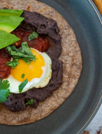 Close up shot of Easy Huevos Rancheros Made with Black Re-fried Beans