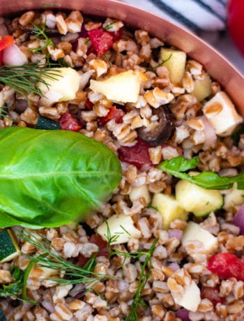 Summer Farro Salad Garnished with Basil leaf