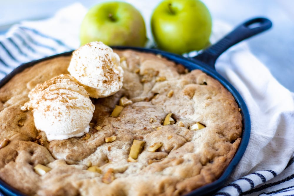 Picture of Apple Cinnamon Blondie Bake with two scoops of Vanilla Ice Cream and two apples in back