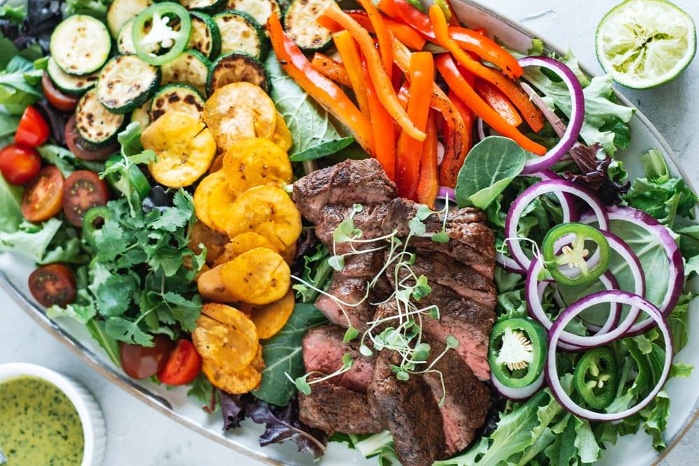 Over had shot of Steak Taco Salad with Cilantro Vinaigrette